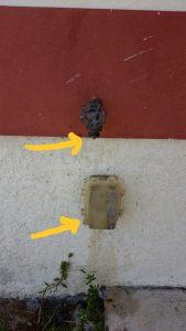 Electrical outlet installed under a water spigot - Safety hazard